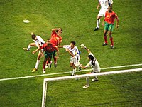 Angelos Charisteas (first from left with white shirt), scoring Greece's winner against Portugal in the final.