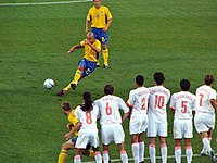 Swedish striker Henrik Larsson taking a free kick against the Netherlands in the quarter-finals