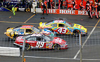 Labonte No. 43 races to the end of pit lane in 2006