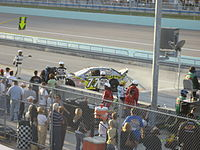 Bobby Labonte brings his car in after a crash during the 2007 Ford 300 at the Homestead-Miami Speedway.