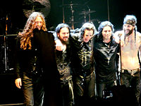 Osbourne (centre) and his touring band in 2011