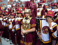 The drum major of the Spirit of Troy wears a more elaborate uniform and conducts the band with a sword.