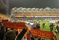 Podgorica City Stadium, Montenegro fans with national features.