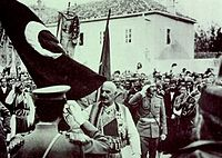 Siege of Scutari, the defeated Ottomans hand over the flag to King Nicholas I of Montenegro.
