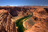 The Colorado was named for the reddish color caused by its natural sediment loads, but damming the river has caused it to acquire a clear green hue as seen here in lower Glen Canyon.