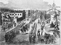 Brown, sitting on his coffin on his way to the gallows. Note lines of soldiers on both side, to avoid a rescue.