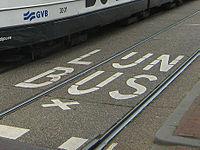 Dutch uses the digraph IJ as a single letter. Shown is a bus road marking saying.