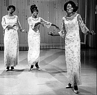 """Diana Ross (front) performing lead vocals on the Supremes' """"My World Is Empty Without You"""" with Florence Ballard and Mary Wilson harmonizing."""