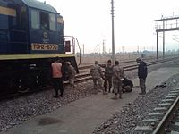 Members of the Afghan Border Police (ABP) search a locomotive near the Hairatan border crossing point in Balkh Province of Afghanistan.