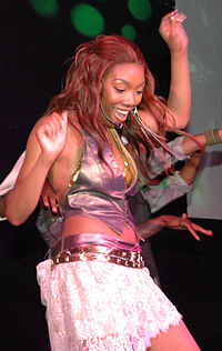 """Norwood performing """"Afrodisiac"""" in July 2004."""