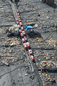 Emergency vehicles staging in the ruins of Otsuchi, Japan following the tsunami