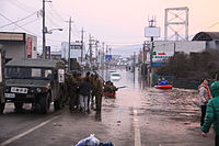 Rescue operations in the floodwaters in downtown Ishinomaki