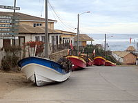 Fishing boats that were moved to higher ground in anticipation of tsunami arrival, in Pichilemu, Chile