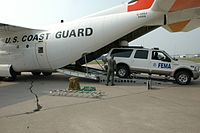 An NRC FEMA First Team truck being loaded onto a Coast Guard plane for flight to Puerto Rico