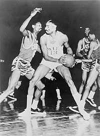 Bill Russell (off ball) was a member of one of the first dynasties in the NBA, winning eight straight titles while contending against Wilt Chamberlain (on ball).