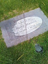 """Betty Hutton's headstone at Desert Memorial Park in Cathedral City, California - her epitaph reads """"Loved by All""""."""