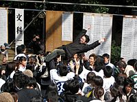 Students celebrating after the announcement of the results of the entrance examinations to the University of Tokyo