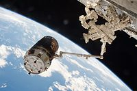 Kounotori 6 grappled by the International Space Station's robotic arm
