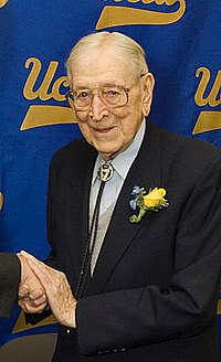 John Wooden, inducted as player in 1960; as coach in 1973