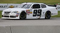 Alex Bowman driving the No. 99 at Road America in 2013