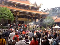 Han Chinese praying at the Lungshan Temple of Manka in Taipei
