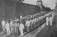 Japanese colonial soldiers march Taiwanese captured after the Tapani Incident in 1915 from the Tainan jail to court.