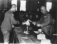 General Chen Yi (right) accepting the receipt of General Order No. 1 from Rikichi Andō (left), the last Japanese Governor-General of Taiwan, in Taipei City Hall