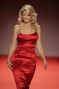 Modeling a dress by Calvin Klein at the 2005 Red Dress Collection fashion show in New York's Bryant Park