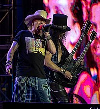 Axl Rose (left) and Slash (right) performing with Guns N' Roses in 2018