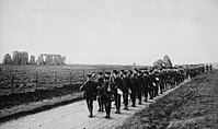 10th Battalion, CEF marches past the site, winter 1914–15 (WW I); Background: Preservation work on stones, propped up by timbers
