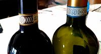 DOCG and DOC labels on two wine bottles
