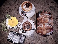 A typical Italian breakfast, consisting of cappuccino and croissant.