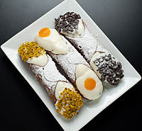 Cannoli with pistachio, candied fruit, and chocolate chips