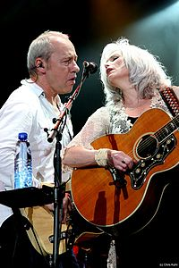 Harris performing with Mark Knopfler, in the Netherlands