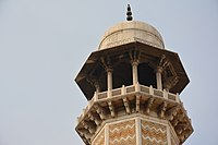 The minarets at the tomb are capped by white marble cupolas