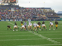The Kent defense lines up against Akron at Dix Stadium on September 30, 2006