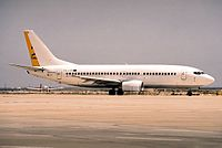 A TAESA Boeing 737 with the rudder (yellow) visible.