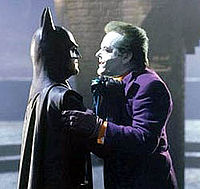 """Batman and the Joker face off in a scene dubbed the """"duel of the freaks""""."""