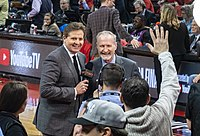 Toronto Raptors commentary team members Matt Devlin and Jack Armstrong in the Scotiabank Arena during Game 2; note the advertisement of YouTube TV (despite its lack of legal availability there at the time) behind the announcers