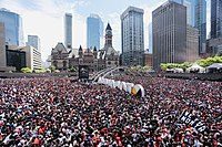 Toronto's Nathan Phillips Square on June 17, 2019 with crowds surrounding the 3D Toronto sign during the victory parade