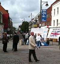 Nick Griffin, leader of the British National Party, talking to voters in Romford Market.