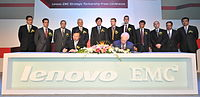 The signing ceremony for the LenovoEMC joint venture, with Yang Yuanqing standing in the middle (fifth from the left) in the back row