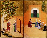 Saadi Shirazi is welcomed by a youth from Kashgar during a forum in Bukhara.
