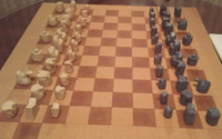 Tamerlane chess, invented by Amir Timur. The pieces approximate the appearance of the chess pieces in 14th century Persia.