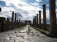 Ancient Roman ruins of Timgadon the street leading to the local Arch of Trajan