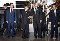 President Abdelaziz Bouteflika and George W. Bush exchange handshakes at the Windsor Hotel Toya Resort and Spa in Tōyako Town, Abuta District, Hokkaidō in 2008. With them are Dmitriy Medvedev, left, and Yasuo Fukuda, right.