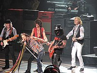Slash performing with Aerosmith in Mansfield, Massachusetts, on July 16, 2014