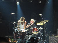 Steven Tyler and Joey Kramer playing drums together at an Aerosmith concert in Chicago, Illinois, on June 22, 2012