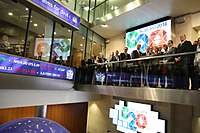 Stock exchanges, characteristic features of the top global cities, are interconnected hubs for capital. Here, a delegation from Australia is shown visiting the London Stock Exchange.