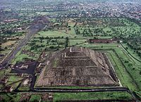 This aerial view of what was once downtown Teotihuacan shows the Pyramid of the Sun, Pyramid of the Moon, and the processional avenue serving as the spine of the city's street system.